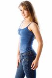 Nice pose. Model wearing blue jeans and blue tank top Stock Photography