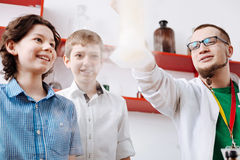 Nice positive boys being fascinated by the chemical experiment Royalty Free Stock Images