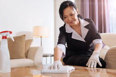 Nice positive hotel maid concentrating on her job Royalty Free Stock Photography