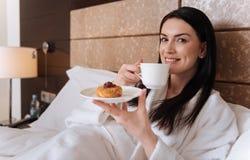 Nice positive woman enjoying her tea Stock Photos