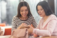 Nice positive women using a tablet royalty free stock photos