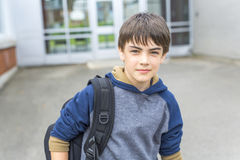 Nice Pre-teen boy outside at school having good time Royalty Free Stock Image