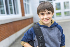 Nice Pre-teen boy outside at school having good time Royalty Free Stock Photos