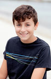 Nice preteen boy smiling. With a black t-shirt Royalty Free Stock Images