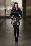 Nice Pretty Girl In Winter Jacket. Portrait Of Young And Beautiful Fashion Model In The Shopping Mall . Professional Makeup And Hair Style Royalty Free Stock Images