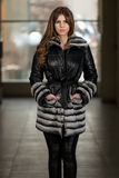 Nice Pretty Girl In Winter Jacket. Portrait Of Young And Beautiful Fashion Model In The Shopping Mall . Professional Makeup And Hair Style Royalty Free Stock Image