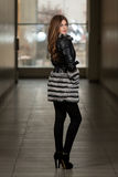 Nice Pretty Girl In Winter Jacket. Portrait Of Young And Beautiful Fashion Model In The Shopping Mall . Professional Makeup And Hair Style Stock Photos