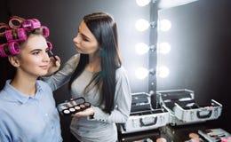 Nice pretty woman having her eye makeup applied Royalty Free Stock Photo