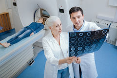 Nice professional doctors consulting each other Stock Photos