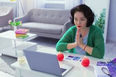 Nice professional fortune teller having a video call. Modern technology. Nice processional fortune teller having a video call while having a session with a stock images