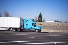 Nice profile semi truck blue green dry van trailer on multy-line Stock Photography