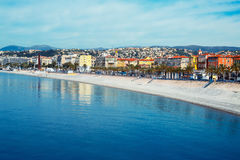 Nice promenade, France. Beautiful Nice promenade, France. View of the sea, beach and Promenade des Anglais Embankment. French Riviera - turquoise sea and perfect royalty free stock photos