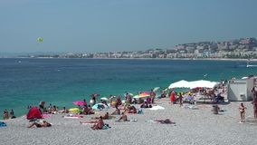 People on Nice beach in France stock footage
