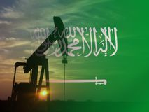 Free Nice Pumpjack Oil Extraction And Cloudy Sky In Sunset With The Saudi Arabia Flag Royalty Free Stock Photo - 156677475