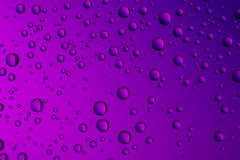 Nice purple blue color background from drops of the different size Stock Image