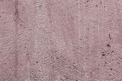 Red scratched stucco with broken paint texture - fantastic abstract photo background. Nice red brushed plaster with damaged paint texture - abstract photo royalty free stock images