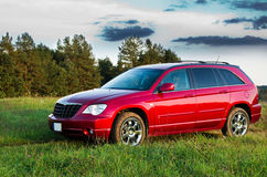 Nice red car. Chrysler Pacifica in a field royalty free stock photography