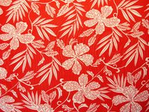 Beautiful red fabric with flowers Royalty Free Stock Photo