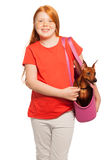 Nice red girl carry dog pet in purse Stock Images