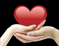 Nice, red heart and two hands Royalty Free Stock Images