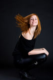 Nice redhead woman playing with her hair royalty free stock image