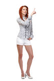Nice redhead woman pointing at copyspace Royalty Free Stock Photography
