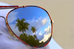 Nice reflection. Nice beach which is reflected in glasses royalty free stock photo