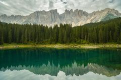 Nice reflection of Dolomites in Lago di Carezza stock photos