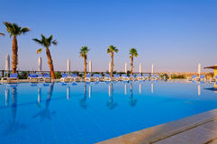 Nice reflection of trees and canopies. Captured this image on one fine morning at pool area of five star hotel in Dead Sea Stock Image
