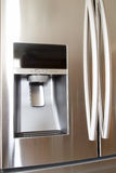 Nice refrigerator ice and water dispenser Stock Photography