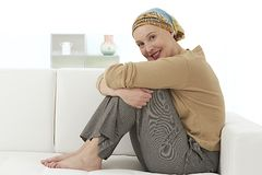 Nice relax woman wearing headscarf. Portrait of a beautiful, courageous cancer patient in a head scarf.at home Stock Photography