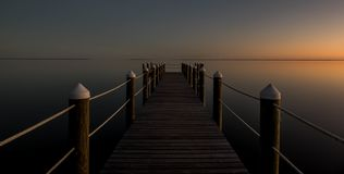 Bay front pier at dusk royalty free stock image