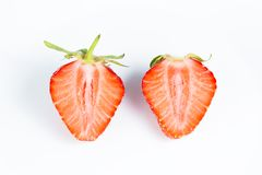 Nice ripe and juicy strawberry cut in half. On white background Stock Photography