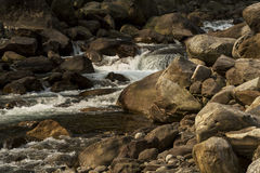 Nice River water flowing through stones and rocks at dawn Royalty Free Stock Photo