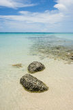 Nice rocks in the clear sea with blue sky  and white clouds in the background Royalty Free Stock Images