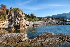 Nice rocky beach at Kassiopi in Corfu, Greece.  stock photography
