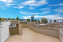 Nice rooftop deck with amazing views of Lake Washington. Seattle and mountains stock photography