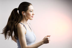 Nice running girl. Young nice running girl listens too music stock images