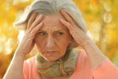 Nice sad old woman Stock Images