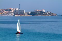 Nice sailboat in a bay near small town Palamos in Costa Brava of Spain.  Stock Photography