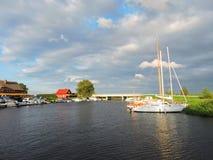 River Minija and ships in village Minge, Lithuania Stock Photo