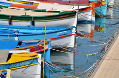 Nice sailing. Small colorfull ships in a Mediterranean port, close up, very Nice, very French Royalty Free Stock Image