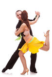Nice salsa dancing couple. With the women holding one leg in the air, looking away from the camera Stock Images