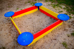 A nice sandbox playground filled . Surrounded by green grass,. Seen from top Royalty Free Stock Images