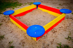 A nice sandbox playground filled . Surrounded by green grass,. Seen from top Stock Photos