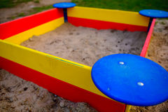 A nice sandbox playground filled . Surrounded by green grass,. Seen from top Stock Images
