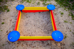 A nice sandbox playground filled . Surrounded by green grass, royalty free stock photo