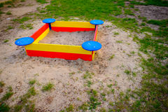 A nice sandbox playground filled . Surrounded by green grass,. Seen from top Royalty Free Stock Photography