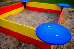A nice sandbox playground filled . Surrounded by green grass,. Seen from top Stock Photography