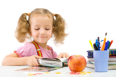 The nice school-girl with the book. Over white Stock Photography